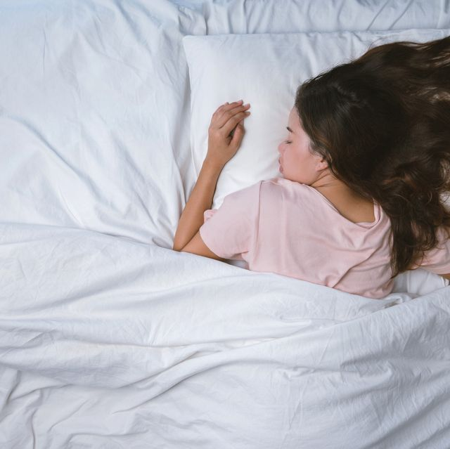 directly above shot of woman sleeping on bed
