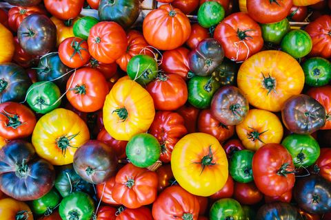 directly above view of multicolored tomatoes on the market stall at farmer's market
