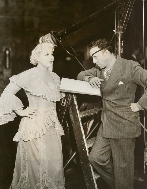 Actress Mae West with Director Raoul Walsh on Set