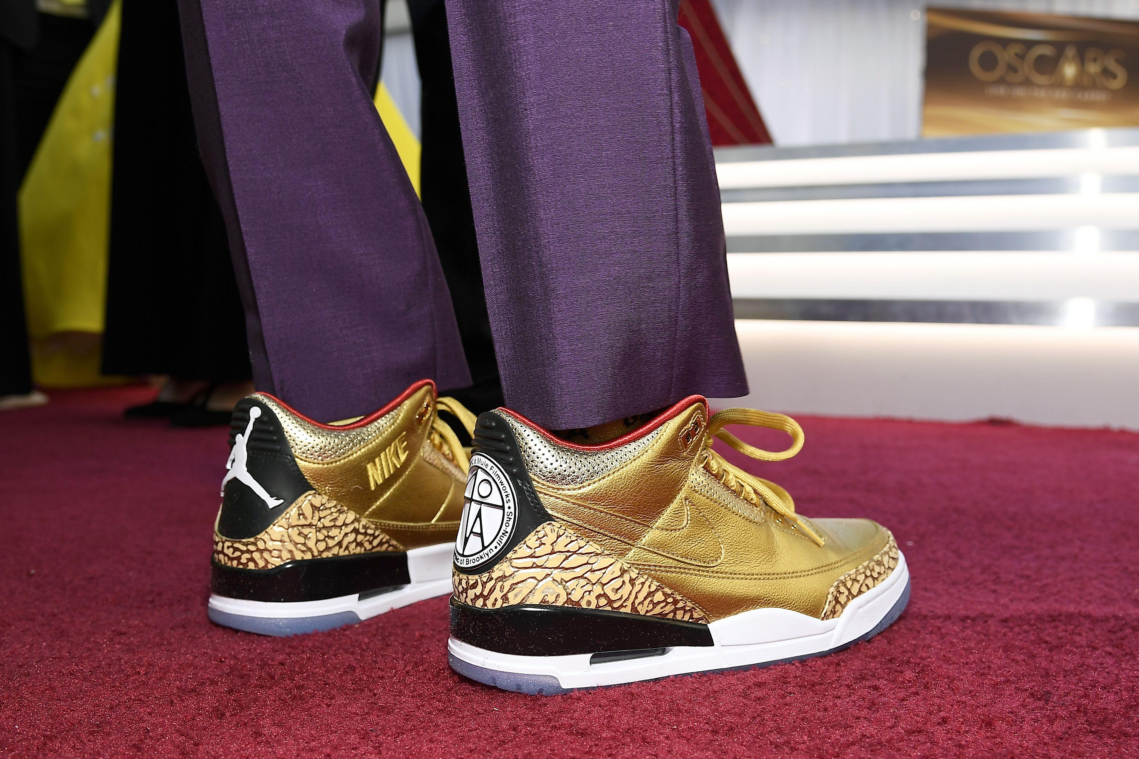 Spike Lee Wore Custom Gold Air Jordan 3