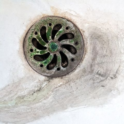 dirty stained sink plug of toilet