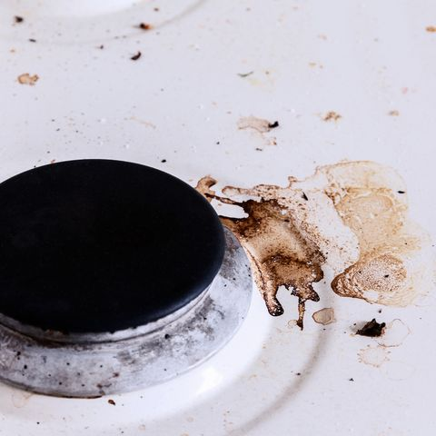 dirty white kitchen stove close-up