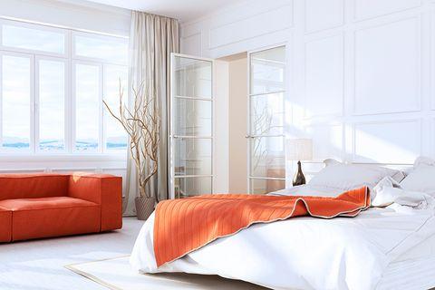 Imagen de habitación con gran ventanal para ilustrar tema de cómo disfrutar de tu casa en verano con Climalit