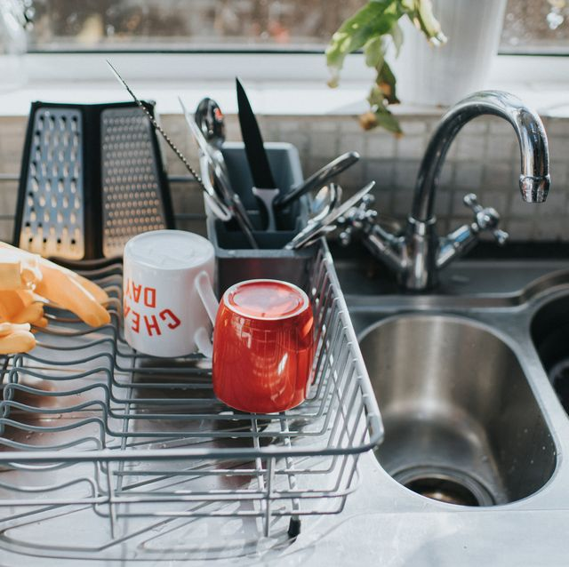dishes in drying rack next to kitchen sink