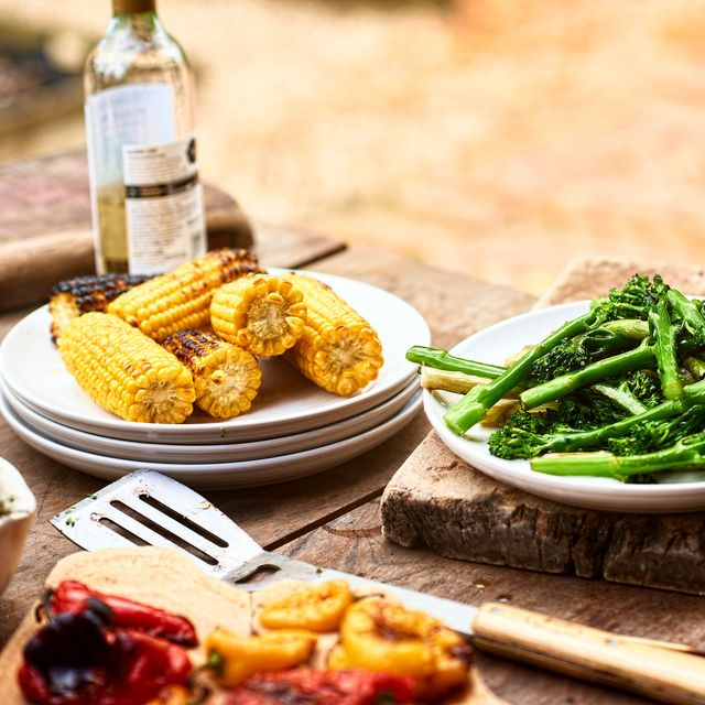 dishes with freshly prepared green vegetables and sweetcorn