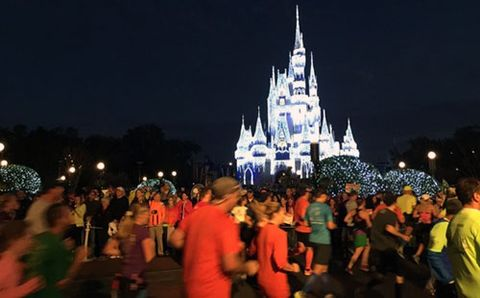 Runners run past Disney castle