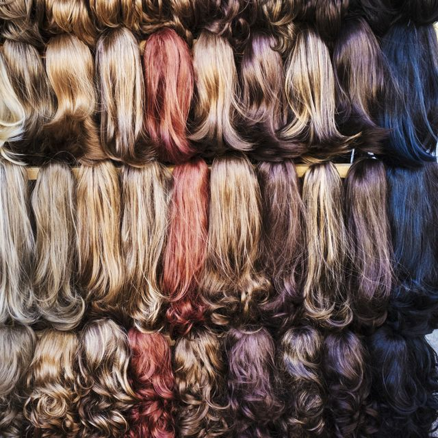 a display of hair extensions and hair pieces of different colours