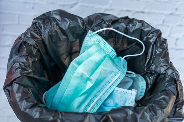 disposing of a used mask in the trash by leaving unhygienic there may be a spread of harmful germs and viruses healthcare concepts