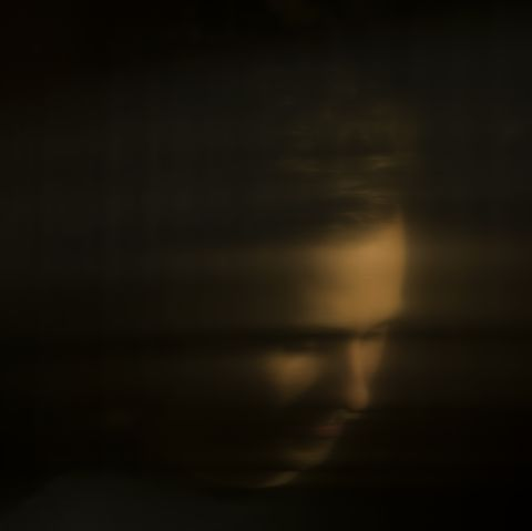 Distorted portrait of a male, reflection
