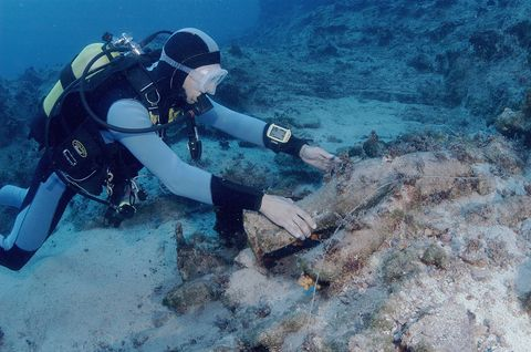 Diver investigating ancient amphora off coast of Turkey, Mediterranean Sea