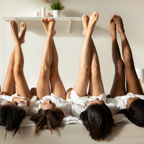 diverse girls lie upside down celebrate hen party