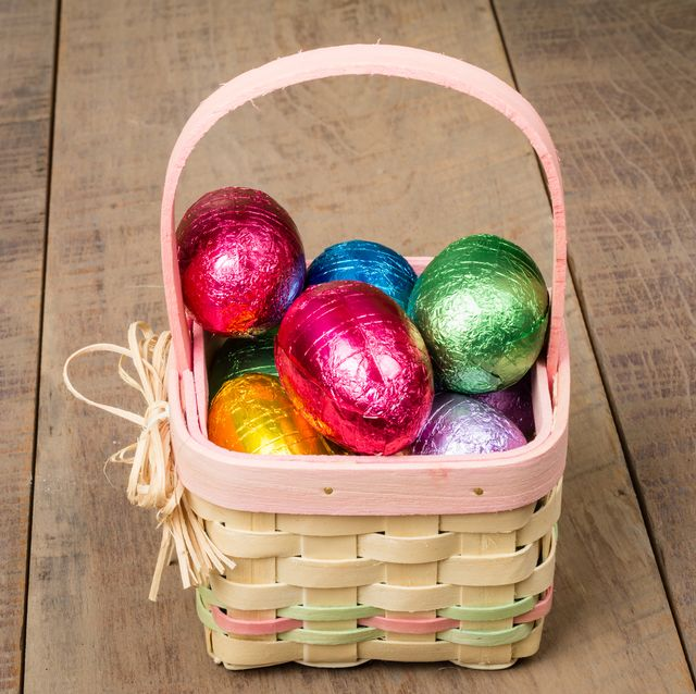 a small wicker easter basket with foil eggs