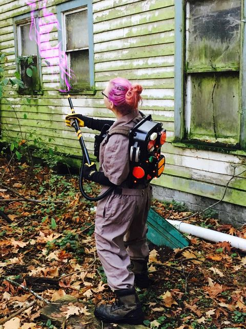women's ghostbusters costume with a colored proton pack and gun