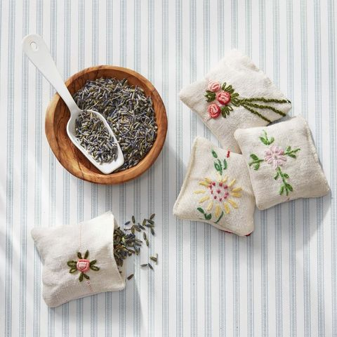 hand stitched lavender pouches with bowl of lavender