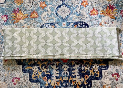 pinning fabric to foam to create a window seat cushion
