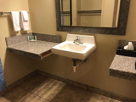 Sink, Bathroom sink, Bathroom, Room, Property, Tap, Plumbing fixture, Floor, Tile, Countertop,