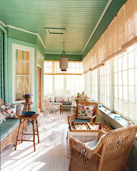 screened in porch with green painted ceiling