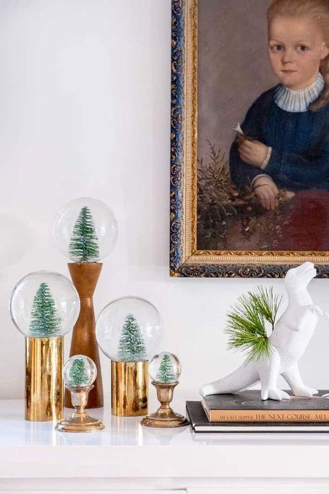 modern snow globes on shelf