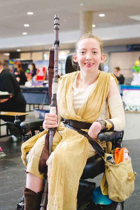 cosplayer dressed as rey from star wars at megacon convention in carlisle