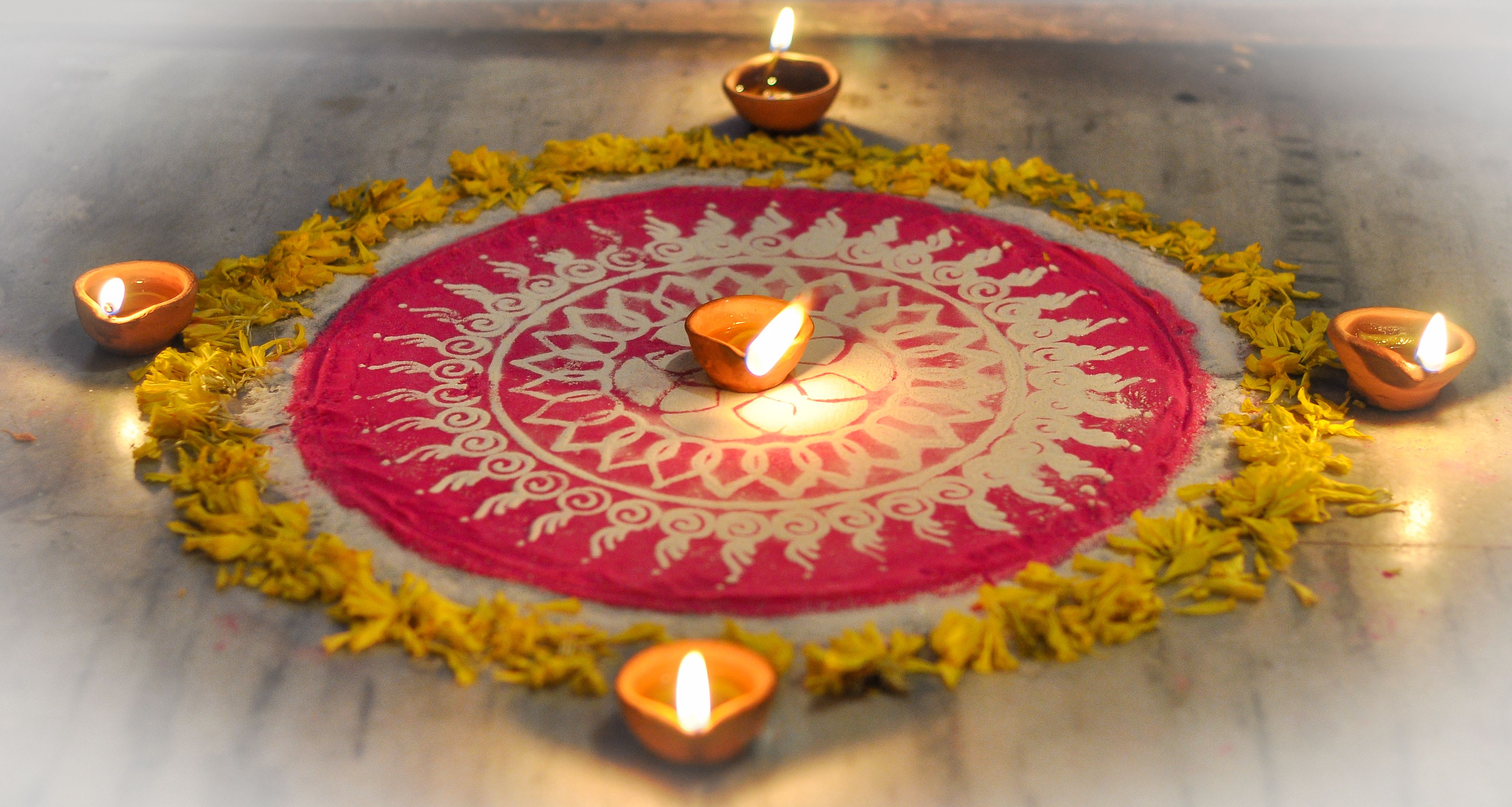 Diyas Decorated On Rangoli During Diwali