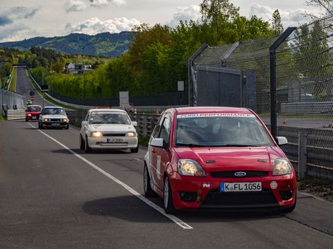 cars lined up at the nurburgring race track in germany
