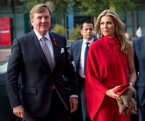 Suit, Red, Formal wear, Outerwear, Event, White-collar worker, Blazer, Tuxedo, Businessperson, Uniform,