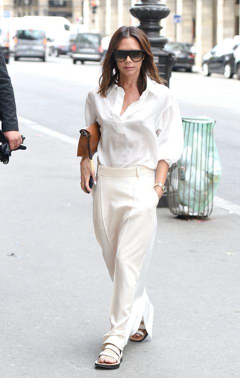 White, Clothing, Street fashion, Eyewear, Fashion, Shoulder, Sunglasses, Footwear, Suit, Waist,