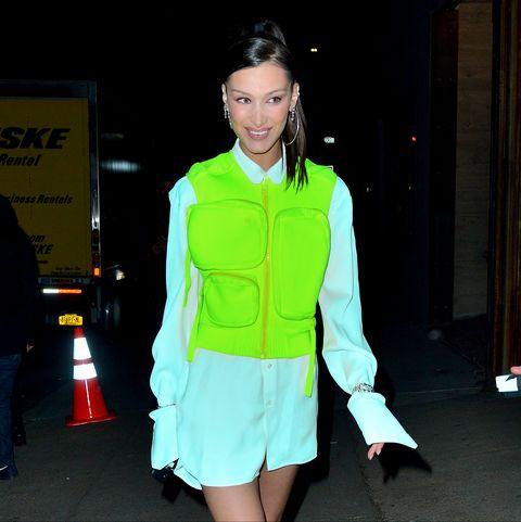 Clothing, Green, Outerwear, High-visibility clothing, Fashion, Street fashion, Jacket, Footwear, Fashion design, Leg,