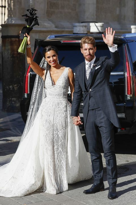 Dress, Wedding dress, Gown, Suit, Bridal clothing, Bride, Fashion, Formal wear, Luxury vehicle, Event,