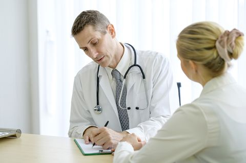 doctor explaining prescription to young woman patient  healthy lifestyle, healthcare, professional occupation concept
