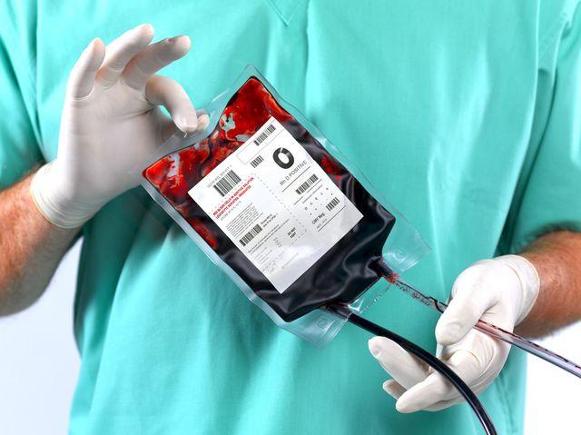doctor holding blood bag