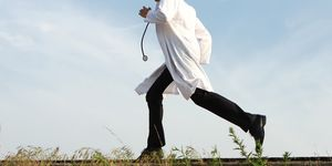 Doctor running, side view