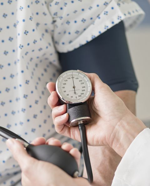 doctor taking patients blood pressure
