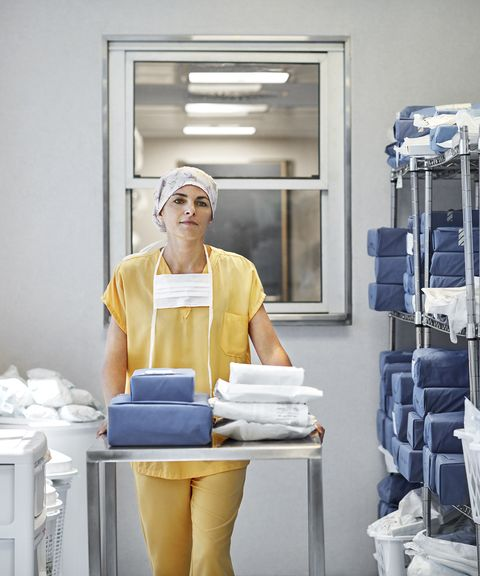 Doctor with medical supplies in storage room