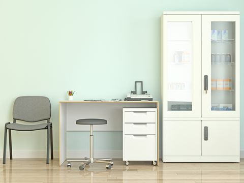 doctor's office with medical equipment and cabinets