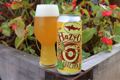 a hazy ipa beer can poured out into a glass