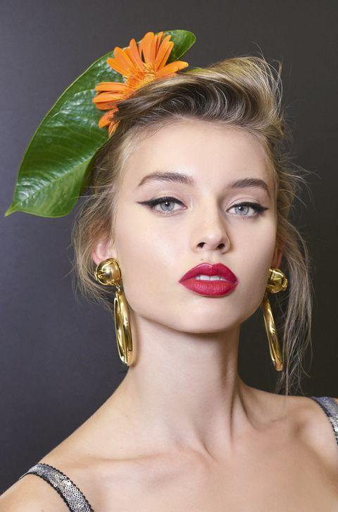 Hair, Head, Lip, Hairstyle, Yellow, Forehead, Eyebrow, Eyelash, Earrings, Style,