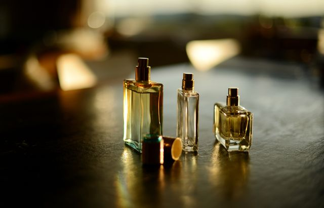 three perfume bottles in a beautiful sunlight