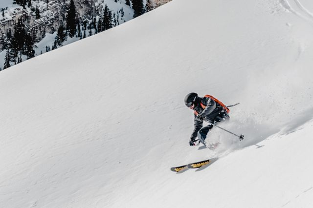 backcountry man skiing on snowy hill