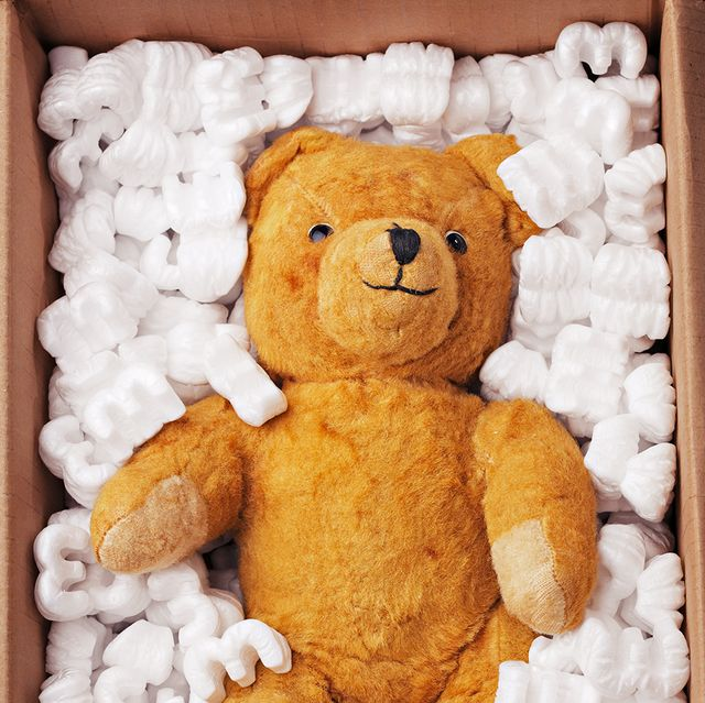 A teddy bear is packed up to be donated. Donating toys for christmas is a great way to declutter.