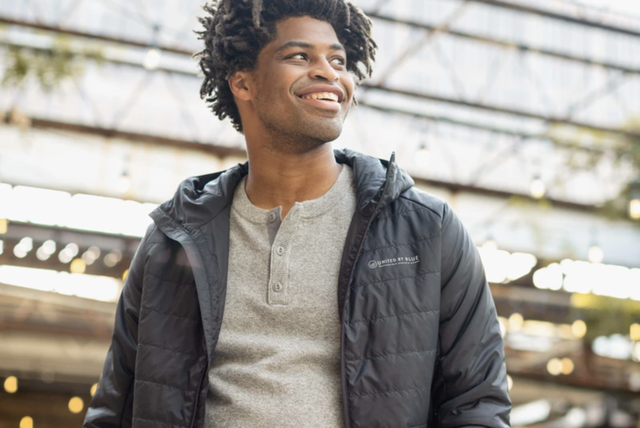 a model wearing a down jacket