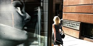 A woman walks past the Commonwealth Bank in Martin Place, Sydney, 28 November 20