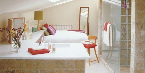 dormitorio con baño integrado