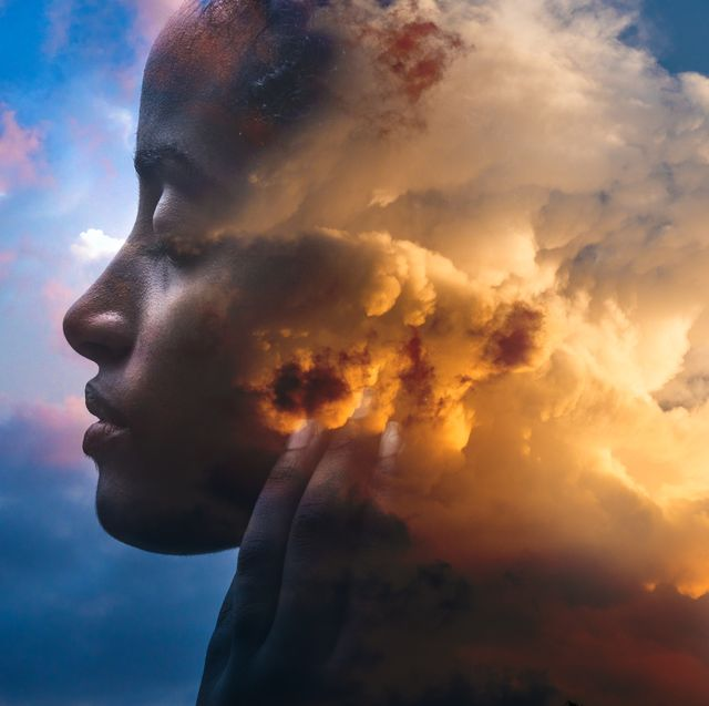 double exposure portrait of a dark skinned woman and a striking sunset