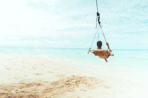 Swing, Fun, Sea, Sky, Vacation, Ocean, Outdoor play equipment, Beach, Recreation, Fishing rod,