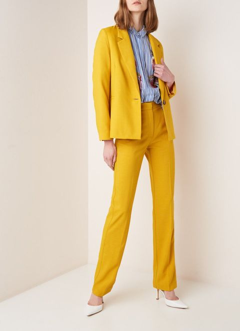 Clothing, Yellow, Outerwear, Suit, Standing, Jacket, Blazer, Fashion, Pantsuit, Trousers,