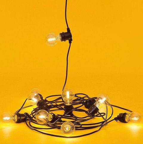 Yellow, Light fixture, Light, Lighting, Amber, Still life photography, Lamp, Liquid, Macro photography, Interior design,