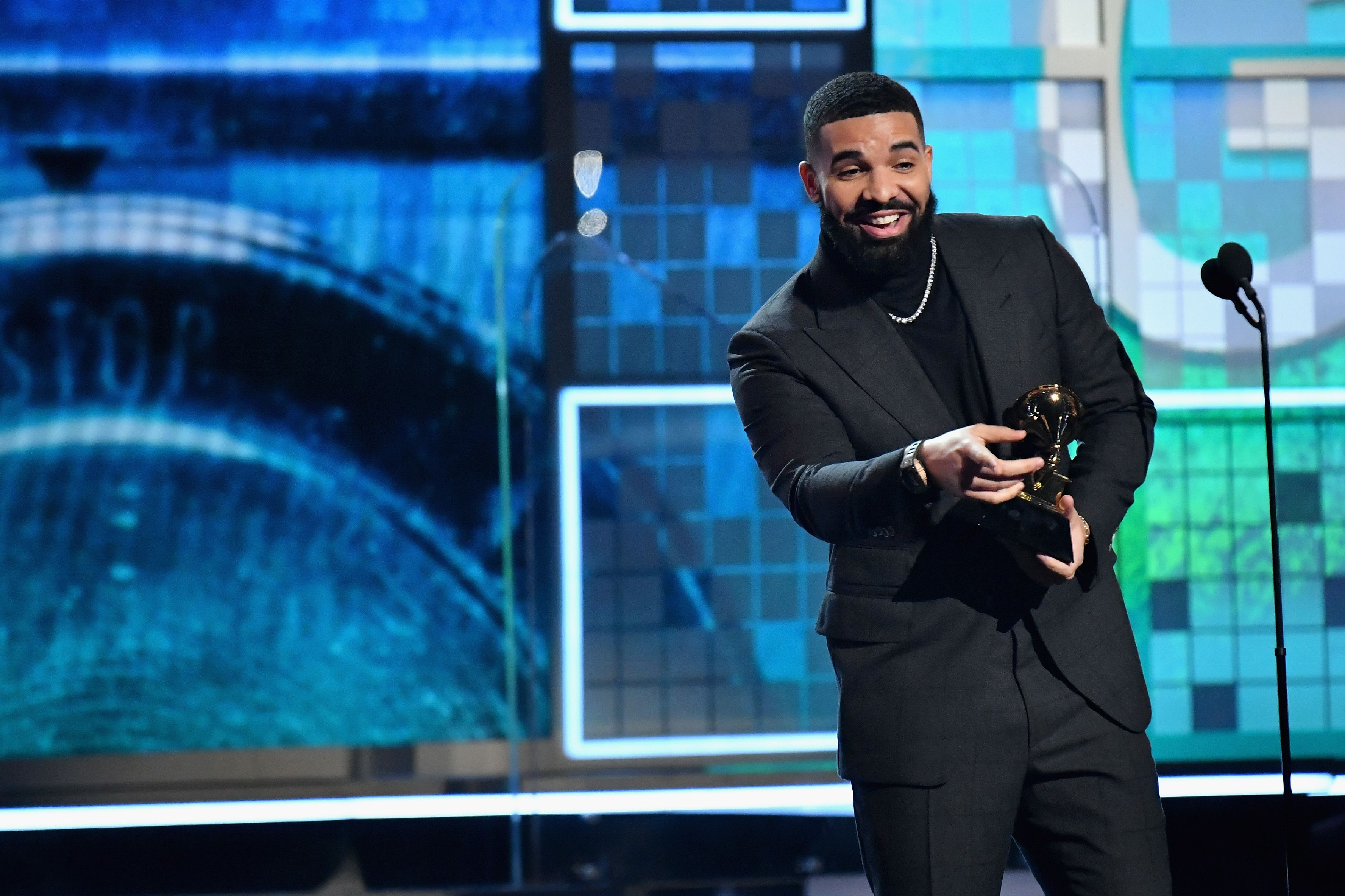 Drake Showed Off His Six-Pack Abs and Fires Back at Plastic Surgery Accusations