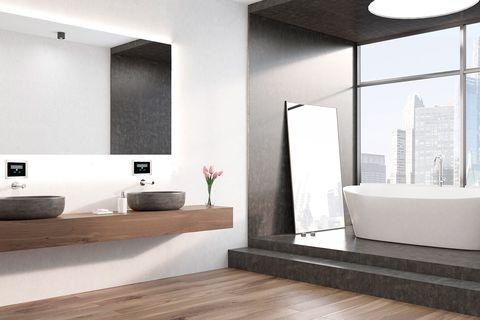 baño moderno con lavabos volados y bañera exenta