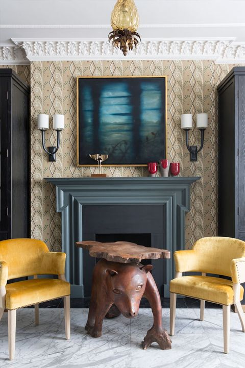 Furniture, Room, Living room, Interior design, Table, Yellow, Floor, Wall, Chair, Hearth,